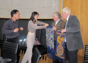 Tadhg Coakley and Dermot Cunningham receiving gifts from a visiting Chinese delegation