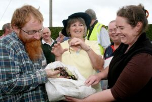 Fun with worms at the launch of another Stop Food Waste Master Composter Site.